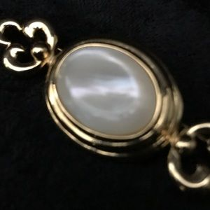 Vintage Monet gold with pearlescent cabochon